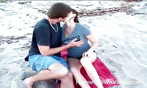 Kissing a beauty that munches his cock on the beach