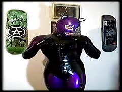 Latex Cat Girl, Shining Her Rubber Catsuit
