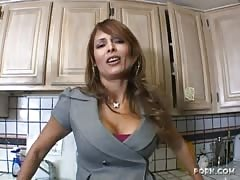 Glamorous mom is trying out a massive black dick in the kitchen