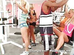Big black fuckers are screwing some white babes on the gym party
